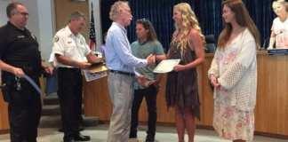 Holmes Beach surf shop fire award Mayor