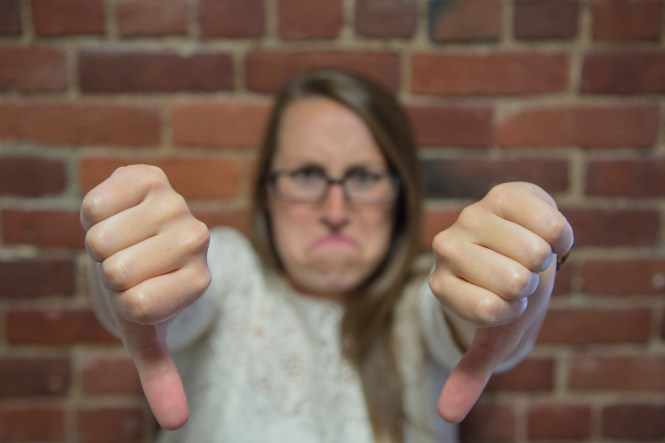 Unhappy woman with Thumbs down