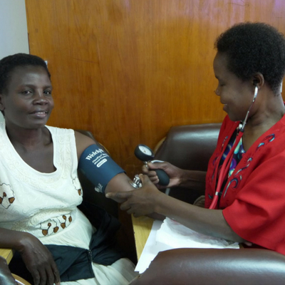 Malawian midwife measuring a pregnant mother's blood pressure