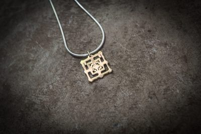 TPB2 - Large brass Bayon on silver chain