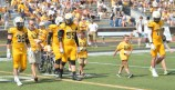 Jeremy Schneider/jeremy.schneider@amnews.com Centre College captains walk to midfield for the coin toss with pediatric cancer survivors and patients prior to the start of Saturday's Gold Out Game.
