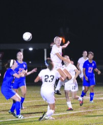 Jeremy Schneider/jeremy.schneider@amnews.com Kylee Thompson of Boyle County goes up for a ball during Monday's Spine Center Classic game against Mercer County at Rebel Stadium. Thompson scored four goals during the Rebels 7-0 win. It also happened to be Thompson's 18th birthday.