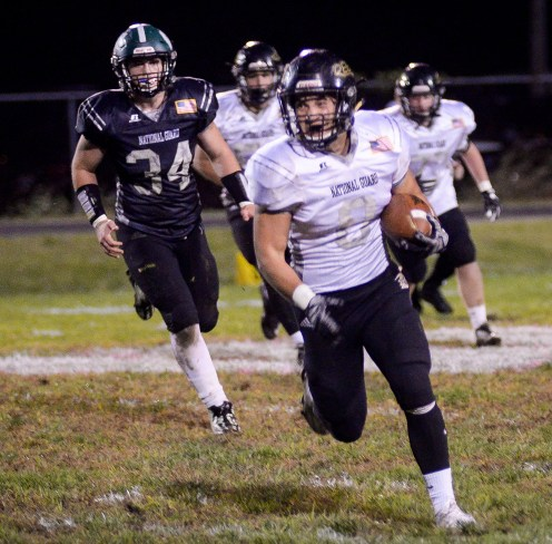 Hannah Brown/Special from The State Journal Boyle County's Christian Reeves gains yards as Western Hills' Bryce Edmondson trails behind during the game at Western Hills High School Friday night.
