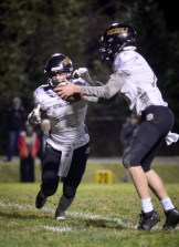 Photo by Hannah Brown/Special from The State Journal Boyle County's Trintin Ashburn fakes a handoff from Sam Tiller during the game against Western Hills High School at WHHS Friday night.