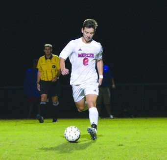 Jeremy Schneider/jeremy.schneider@amnews.com Juan Mercado of Mercer County dribbles the ball outside the 18-yard line during the first half of Monday's 5-0 win over Lexington Catholic.