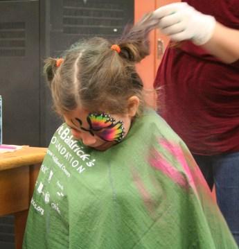 Kendra Peek/kendra.peek@amnews.com Autumn Douglas, 3, gets her hair sprayed during the Juction City Elementary Fall Festival.