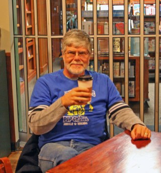 Kendra Peek/kendra.peek@amnews.com Richard Stallings enjoys a coffee at The Hub Coffee House and Cafe at the end of his Pints for Pets Pub Crawl.