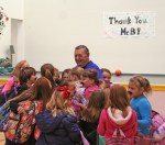 Kendra Peek/kendra.peek@amnews.com Perryville Elementary School students swarm Ronnie Bottoms after the Nov. 22 announcement of Ronnie Bottoms Day, and his pending retirement on Nov. 30.