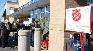 Members of the Salvation Army Brass Band played Christmas songs outside of Kroger to celebrate the start of the bell ringing season.