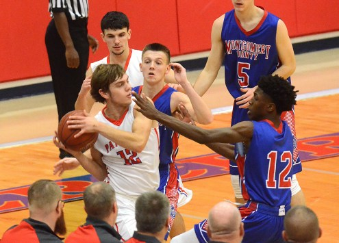 LINCOLN'S Noah Young looks for an open man after getting trapped by Montgomery's Tucker Norris and Pharoah Davis in front of the Patriot bench during the Clash of the Titans Tournament at Mercer County Wednesday. Young and Devin Alcorn had 22 points apiece in Lincoln's 55-41 win. Photo by Nancy Leedy