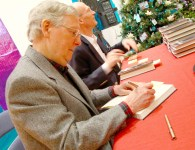 Ben Kleppinger/ben.kleppinger@amnews.com U.S. Sen. Mitch McConnell signs copies of his newest book at the Boyle County Republicans' Christmas party Tuesday night.