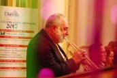Seen through green and purple streamers, globally acclaimed trumpeter Vincent DiMartino performs early in the evening.