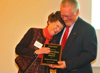 Photos by Ben Kleppinger/ben.kleppinger@amnews.com | Barbara Hulette, left, leans on award presenter Bob Miller as she receives a standing ovation while accepting the Danville-Boyle County Chamber of Commerce's Outstanding Citizen Award Friday night.
