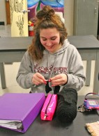 Kendra Peek/kendra.peek@amnews.com Cloe Shear crochets a hat during Shelly Stinnet's class at Danville High School.