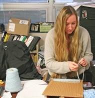 Kendra Peek/kendra.peek@amnews.com Sarah Goosey weaves a scarf during Shelly Stinnet's class at Danville High School.