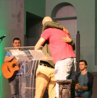 Kendra Peek/kendra.peek@amnews.com Rob Rodriguez and Jason Kilby hug after Rodriguez shared his journey through addiction and recovery during a meeting of the Hope Network on Tuesday.