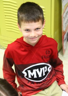 """Ben Kleppinger/ben.kleppinger@amnews.com   Nate Snow wears a red hoodie decorated with """"Go Falcons"""" and """"Tamme"""" written in Sharpie."""