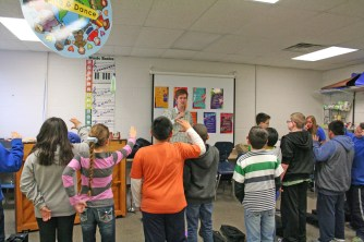 Kendra Peek/kendra.peek@amnews.com Conner Kinman teaches students to play the trumpet at Hogsett Elementary School.