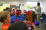 Kendra Peek/kendra.peek@amnews.com Students at Hogsett Elementary School learn to play the trumpet from Conner Kinman.