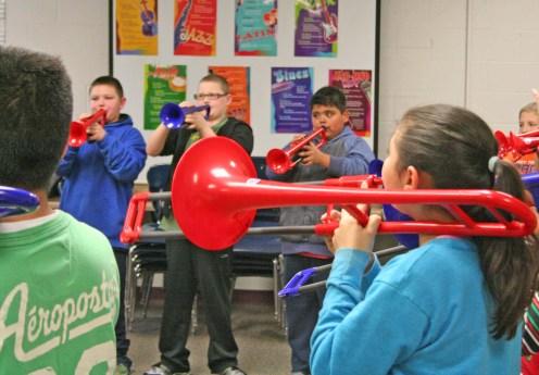 "Kendra Peek/kendra.peek@amnews.com Students at Hogsett Elementary play ""Go Big Blue"" on the trumpet and the trombone."