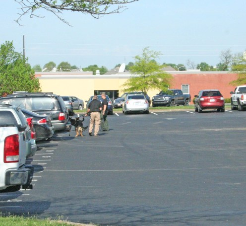 Kendra Peek/kendra.peek@amnews.com Boyle K9 Deputies Keith Addison and Casey McCoy with K9s Aja and NiKi, respectively, check cars in the parking lot of the Boyle County High School.