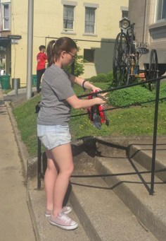 Photo submitted Danville High School Student Morgan France wraps a railing at the Community Arts Center early Thursday morning.