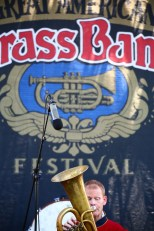 A horn player with Saxton's Cornet Band performs on the main stage Saturday afternoon. (Photo by Ben Kleppinger)