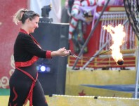 "Circus performer ""Jamie"" swings fiery balls as part of an act Wednesday evening."