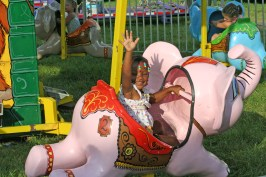 Kendra Peek/kendra.peek@amnews.com Jay'onna Grey, 3, rides the flying elephants at the Boyle County Fair Friday night.