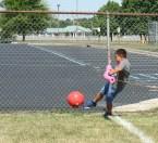 Kendra Peek/kendra.peek@amnews.com Andrew Ellis kicks a ball in human foosball at Black and Gold Academy.