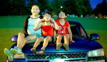 Photos by Ben Kleppinger/ben.kleppinger@amnews.com From left, 12-year-old Kelly, 6-year-old Naomi and 6-year-old Melanie enjoy the show from the hood of a Chevy pickup.