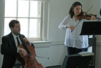 Kendra Peek/kendra.peek@amnews.com Luke and Sila Darville, owners of Darville String studio, play their cello and violin, respectively.