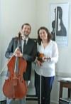 Kendra Peek/kendra.peek@amnews.com Luke and Sila Darville at the Darville String Studio in Danville.