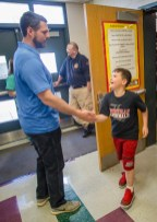 Jacob Tamme high-fives Peyton Leffew as he leaves the Junction City Elementary gym Friday morning.