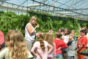 On Thursday, the second day of the Boyle County High School FFA Greenhouse Sale, agriculture science teacher and FFA advisor Toni Myers explains how the plants are grown to a visiting second-grade class from Woodlawn Elementary School.