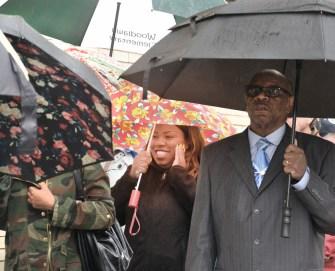 Marchers make their way through the rain Sunday.
