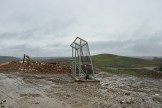 One of many metal cages, that resemble over-sized soccer goals is on location of a dump site. On windy days these cages are pushed together by bulldozers to form a barrier to trap garbage from blowing away.