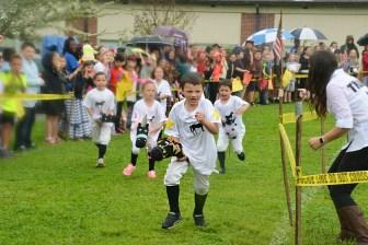 Keegan Walker leads his heat in the kindergarten student's Kidtucky Derby.