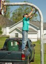 Photos submitted Shaun Parker scrapes paint off a basketball goal at Cowan Park on May 1.