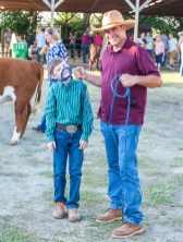 Rob Kernodle, right, goofs off with his son, Joshua Kernodle, 11. The pair were at the fair to show Hereford cows.