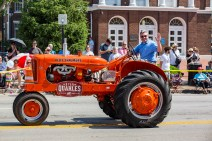 Kentucky Agriculture Commissioner Ryan Quarles drives a customized tractor down Main Street.