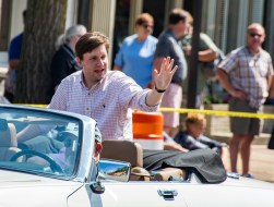 State Rep. Daniel Elliott waves from the back of a convertible.