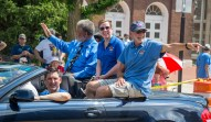 Danville City Commissioners, seated on convertible from left, J.H. Atkins, Denise Terry and Rick Serres wave to the crowd. Seated in the passenger seat is City Commissioner Kevin Caudill.