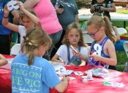 Kendra Peek/kendra.peek@amnews.com Maggie Schommer, 10, Lindsey Porter, 7 and Lilly Porter, 10, decorate masks at the Creation Station in the Great American Brass Band Festival.