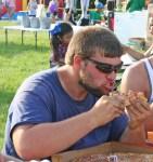 Kendra Peek/kendra.peek@amnews.com Travis Watson bites into pizza.