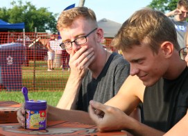 Kendra Peek/kendra.peek@amnews.com William Carlson, left, recovers from eating a centipede-flavored jelly bean while Derek Braymer examines his jelly bean in the Bean Boozled Challenge.