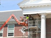 Kendra Peek/kendra.peek@amnews.com Dave Tucker with Griggs Enterprises works on the flashing for the front of Toliver Elementary School. The wooden columns are being replaced with fiberglass ones.
