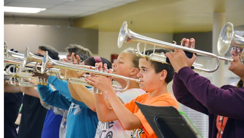 Photo by Robin Hart/robin.hart@amnews.com Brandon Dorn watches the band leader as the horn section warms up Tuesday morning in the Boyle County High School cafeteria Tuesday morning.