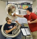 Photo by Robin Hart/robin.hart@amnews.com Boyle County Bands Director Matt Emerson, checks a tuba player's tone during the indoor morning practice in the high school's cafeteria Tuesday morning.
