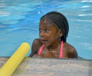 Brianna Hylton is all wet after she practices putting her face under water during a swimming lesson Wednesday evening.